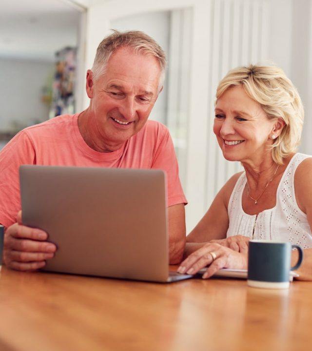 couple reviewing their investment portfolio reports